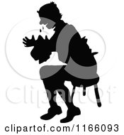 Clipart Of A Silhouetted Man Crying And Sitting In A Chair Royalty Free Vector Illustration