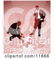 Two Businessmen Completing A Red Jigsaw Puzzle Together Clipart Illustration