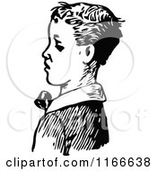 Clipart Of A Retro Vintage Black And White Boy In Profile Royalty Free Vector Illustration