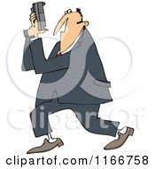 Cartoon Of A Secret Agent Man Holding Up His Firearm Royalty Free Vector Clipart