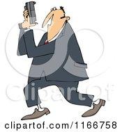 Secret Agent Man Holding Up His Firearm