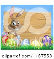 Cartoon Of A Brown Easter Bunny With Eggs In Grass And A Basket By A Wood Sign With Blue Sky Royalty Free Vector Clipart
