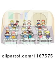Cartoon Of Diverse School Children Writing At Their Desks Royalty Free Vector Clipart
