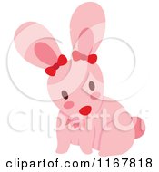 Cartoon Of A Cute Pink Bunny Rabbit With Bows Royalty Free Vector Clipart