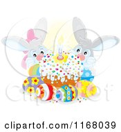Cartoon Of A Cake With Easter Eggs And Bunnies Royalty Free Vector Clipart