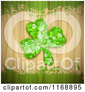Clipart Of A St Patricks Day Shamrock Made Of Clovers Over Wood With Grunge Royalty Free Vector Illustration