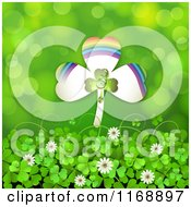 Clipart Of A Rainbow St Patricks Day Shamrock Over Clovers And Flowers On Green Royalty Free Vector Illustration
