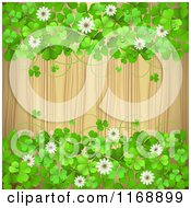 Clipart Of A Green St Patricks Day Background With Shamrock Clovers And Flowers Over Wood 2 Royalty Free Vector Illustration