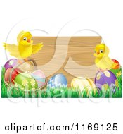 Cartoon Of Easter Chicks On Eggs In Front Of A Wooden Sign Royalty Free Vector Clipart