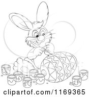 Cartoon Of An Outlined Easter Bunny Painting An Egg Royalty Free Vector Clipart
