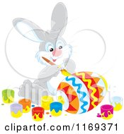 Cartoon Of An Easter Bunny Painting A Large Egg Royalty Free Vector Clipart