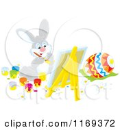 Cartoon Of An Easter Bunny Painting An Egg On A Easel Royalty Free Vector Clipart