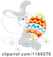 Cartoon Of An Easter Bunny Carrying A Large Egg Royalty Free Vector Clipart