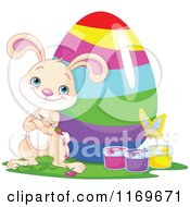 Cartoon Of A Beige Bunny Standing Proudly By A Painted Easter Egg Buckets And Butterfly Royalty Free Vector Clipart