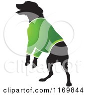 Clipart Of A Silhouetted Dog Wearing A Green Sweater Royalty Free Vector Illustration