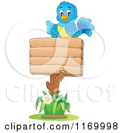 Cartoon Of A Happy Bluebird Pointing Over A Wooden Sign Royalty Free Vector Clipart
