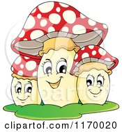 Cartoon Of A Trio Of Happy Mushrooms Royalty Free Vector Clipart by visekart