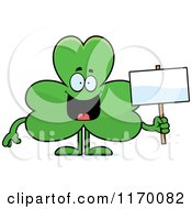 Cartoon Of A Happy Shamrock Mascot Holding A Sign Royalty Free Vector Clipart