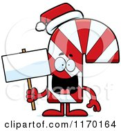 Cartoon Of A Happy Candy Cane Mascot Holding A Sign Royalty Free Vector Clipart
