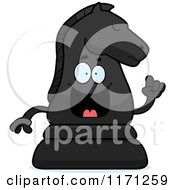 Cartoon Of A Smart Black Chess Knight Mascot With An Idea Royalty Free Vector Clipart