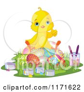 Cartoon Of A Cute Easter Chick Giving A Thumbs Up And Sitting On Painted Eggs Royalty Free Vector Clipart by Pushkin
