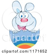 Cartoon Of A Happy Easter Bunny In An Egg Shell Royalty Free Vector Clipart