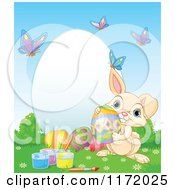 Cartoon Of A Cute Beige Easter Bunny With Paint And Eggs By A Frame With Butterflies Royalty Free Vector Clipart