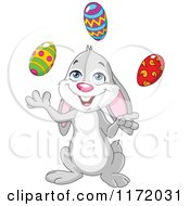 Cartoon Of A Happy Easter Bunny Juggling Eggs Royalty Free Vector Clipart
