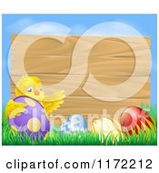 Cartoon Of A Wooden Sign With A Chick And Easter Eggs Against Blue Sky Royalty Free Vector Clipart
