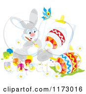 Cartoon Of A Gray Easter Bunny Painting An Egg On An Easel Royalty Free Vector Clipart