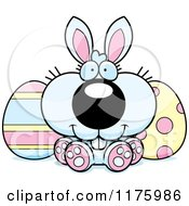 Cartoon Of A Happy Easter Bunny Sitting With Eggs Royalty Free Vector Clipart