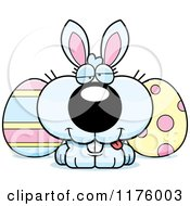 Cartoon Of A Goofy Easter Bunny With Eggs Royalty Free Vector Clipart