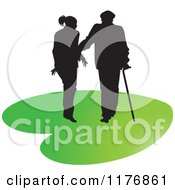 Clipart Of A Silhouetted Caring Nurse Walking With A Man And A Cane On A Green Heart Royalty Free Vector Illustration