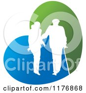 Clipart Of A Silhouetted Caring Nurse Walking With A Man And A Cane On A Blue And Green Heart Royalty Free Vector Illustration by Lal Perera
