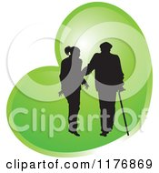 Clipart Of A Silhouetted Caring Nurse Walking With A Man And A Cane Over A Green Heart Royalty Free Vector Illustration by Lal Perera