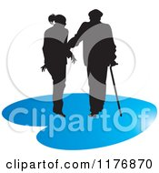 Clipart Of A Silhouetted Caring Nurse Walking With A Man And A Cane On A Blue Heart Royalty Free Vector Illustration by Lal Perera