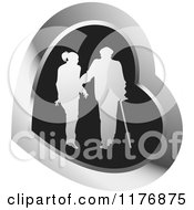 Clipart Of A Silhouetted Caring Nurse Walking With A Man And A Cane In A Black And Silver Heart Royalty Free Vector Illustration