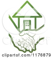Clipart Of A Green Young Hand Holding A Senior Hand With A House Royalty Free Vector Illustration
