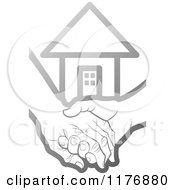 Clipart Of A Silver Young Hand Holding A Senior Hand With A House Royalty Free Vector Illustration