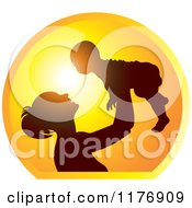 Clipart Of A Nurturing Mother Holding Up A Baby Against A Sunset Royalty Free Vector Illustration
