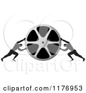 Clipart Of Two Men Pushing Inward On A Silver Film Reel Royalty Free Vector Illustration by Lal Perera