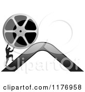 Clipart Of A Silhouetted Man Pushing A Film Reel Over A Mountain Royalty Free Vector Illustration by Lal Perera