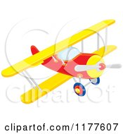 Cartoon Of A Red And Yellow Biplane Royalty Free Vector Clipart