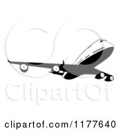 Clipart Of A Black And White Commercial Jet Airliner Royalty Free Vector Illustration by AtStockIllustration