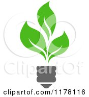 Clipart Of A Green Leaf Sustainable Energy Lightbulb Royalty Free Vector Illustration