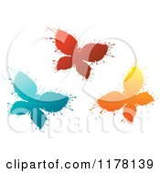 Clipart Of Red Blue And Orange Ink Splatter Butterflies Royalty Free Vector Illustration by Vector Tradition SM