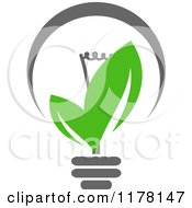 Clipart Of A Green Leaf Sustainable Energy Lightbulb 4 Royalty Free Vector Illustration