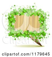 Clipart Of A Wooden Speech Balloon Framed In Shamrocks Flowers And Ladybugs Royalty Free Vector Illustration by merlinul