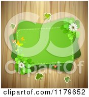 Clipart Of A Green Rectangles With Butterflies Clover Flowers And Shamrocks Over Wood Royalty Free Vector Illustration