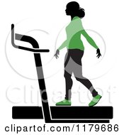 Clipart Of A Silhouetted Woman In A Green Outfit Walking On A Treadmill Royalty Free Vector Illustration